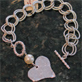 hammered heart bracelet with pearl