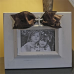 Cream Photo Frame with Brown Sash and Cross